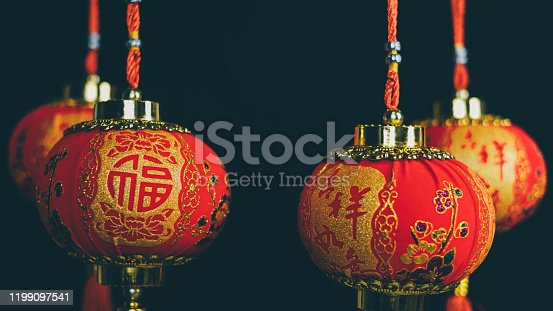 1176499937 istock photo Chinese lanterns on black background in china town.2020 Chinese New Year Rat zodiac sign.Chinese translate: Happy New Year 1199097541
