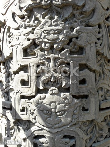 Chinese lion carving on stone
