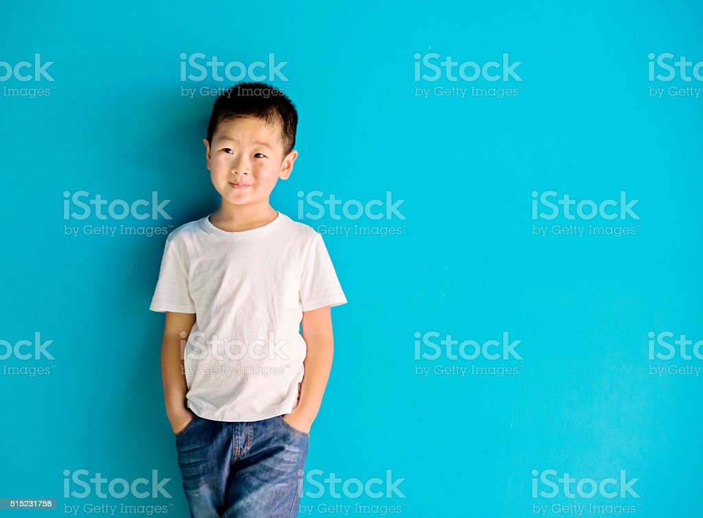 Chinese little boy against wall stock photo
