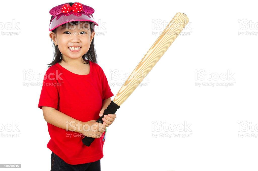 Chinese little girl holding baseball bat stock photo