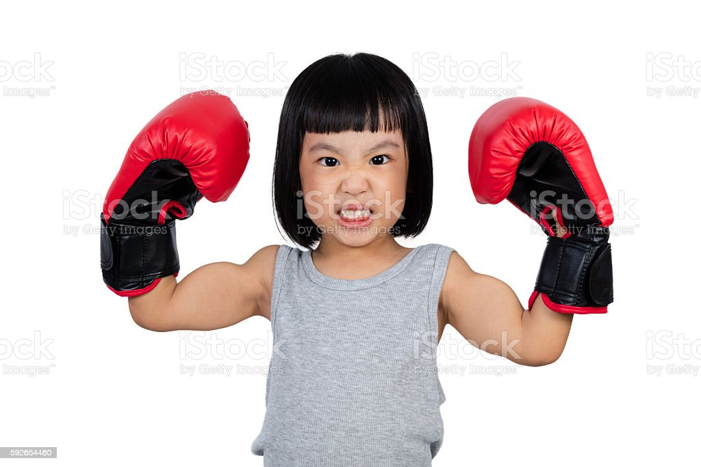 Chinese little girl wearing boxing glove stock photo
