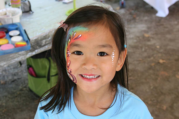 Chinese little girl with face painted stock photo