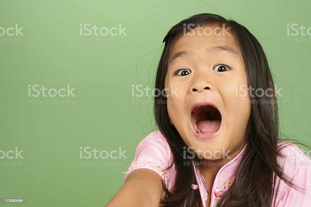 Chinese little girl with surprised expression royalty-free stock photo