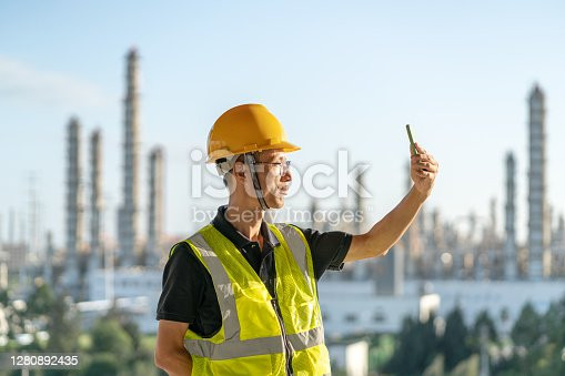 istock Chinese male engineers use mobile phones in chemical plants 1280892435