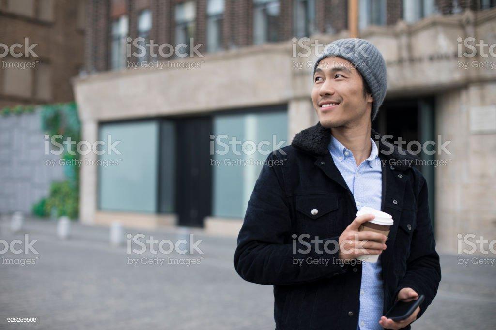 Chinese man having a coffee. stock photo