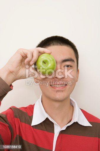 Chinese man holding an apple