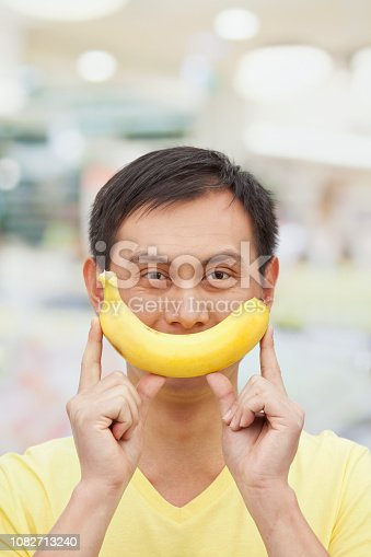 Chinese man holding banana