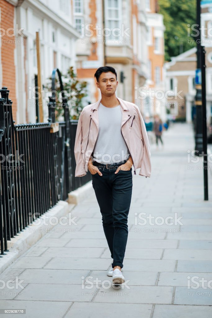 4f617a5b54987 Chinese man in street style fashion walking down the street royalty-free  stock photo