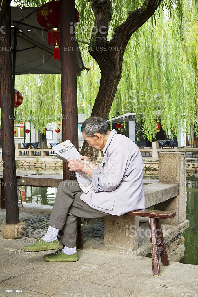 Chinese man reading a newspaper stock photo