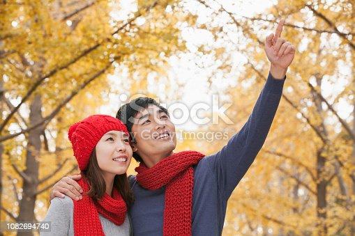 Chinese man showing something to girlfriend