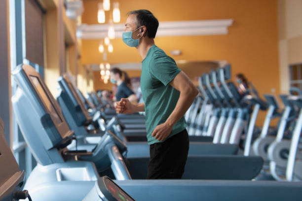 Chinese man wearing mask at the gym