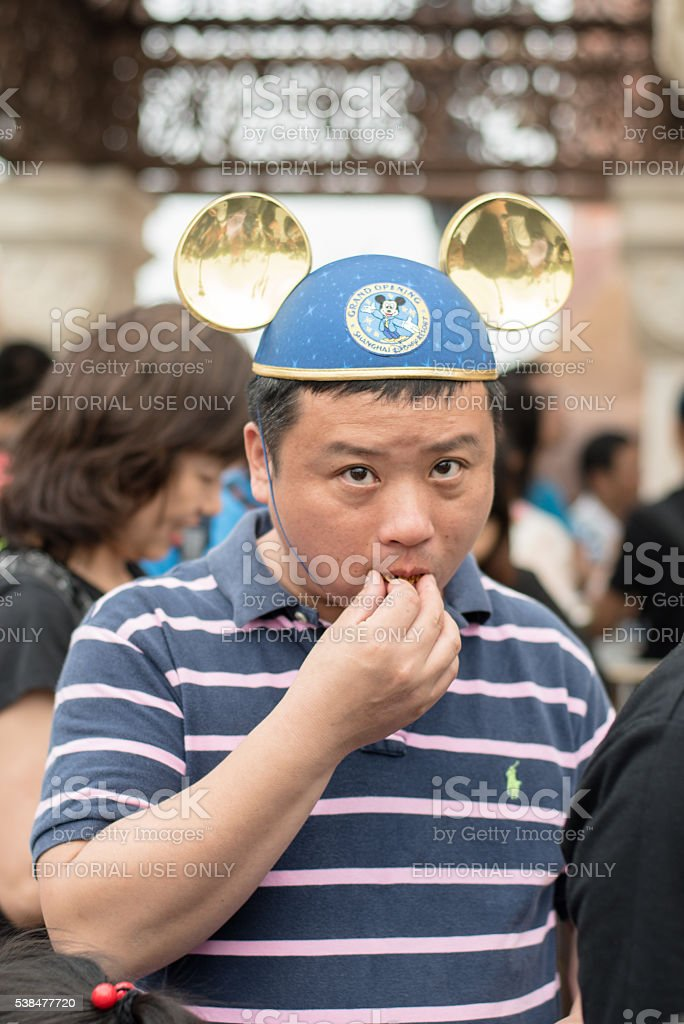 Chinese man with Mickey Mouse hat stock photo
