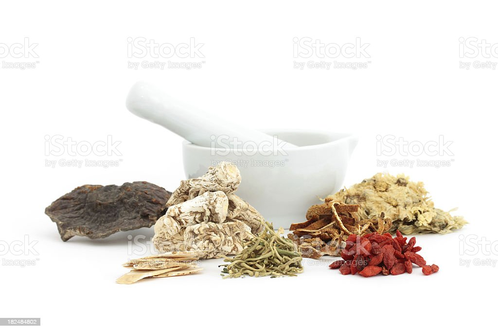 Chinese medical herbs and mortar stock photo