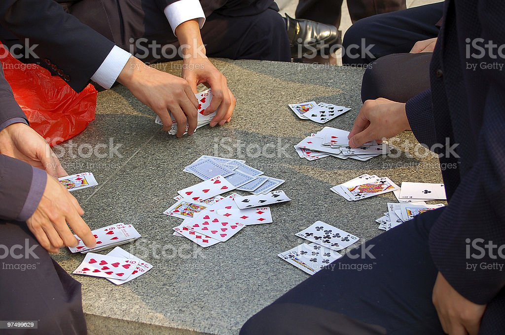 Chinese men playing cards royalty-free stock photo