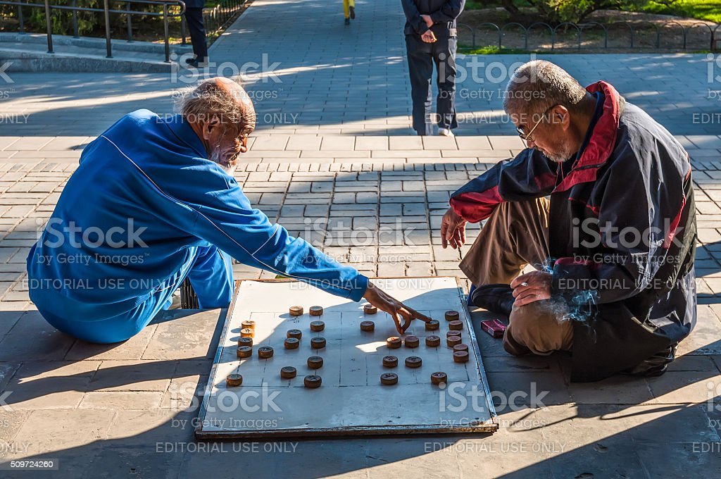 Chinese men playing Chinese chess called Xiangqi stock photo