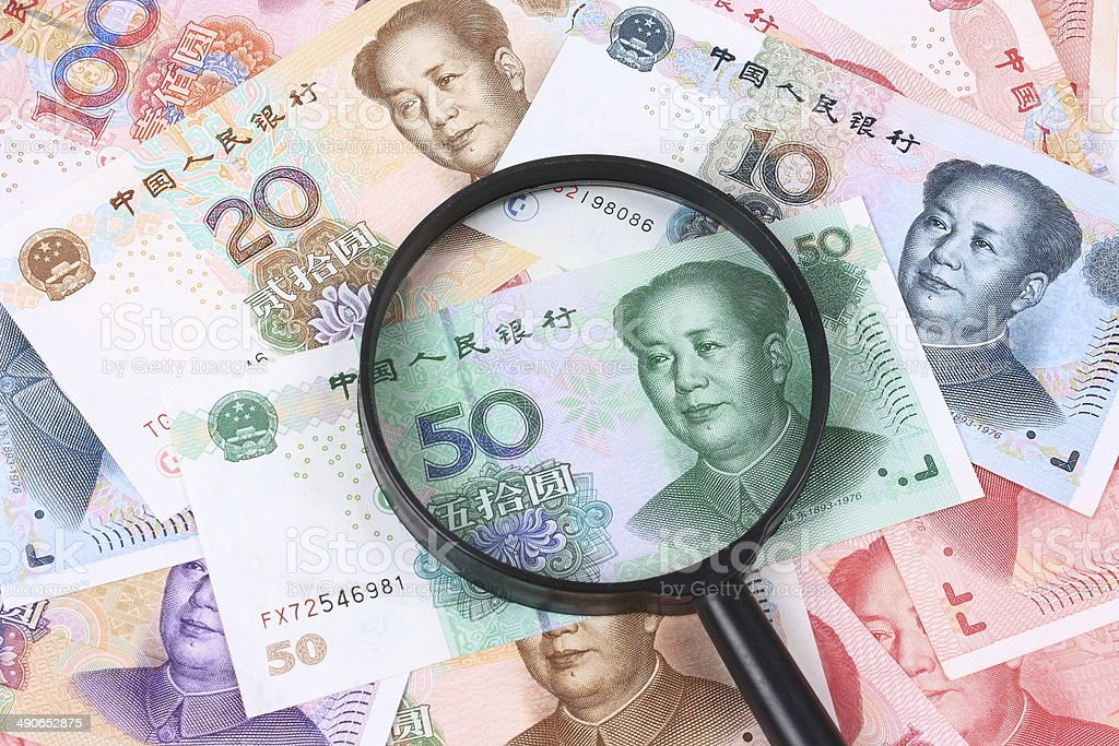 Chinese money and the magnifier stock photo