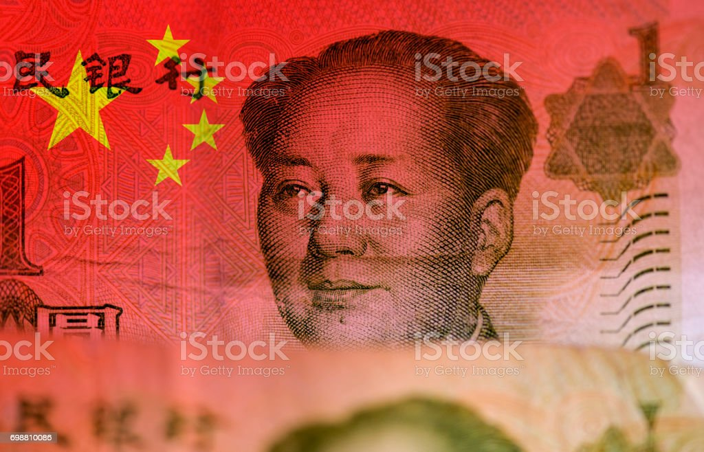 Chinese money, flag of China and face of Mao Zedong stock photo