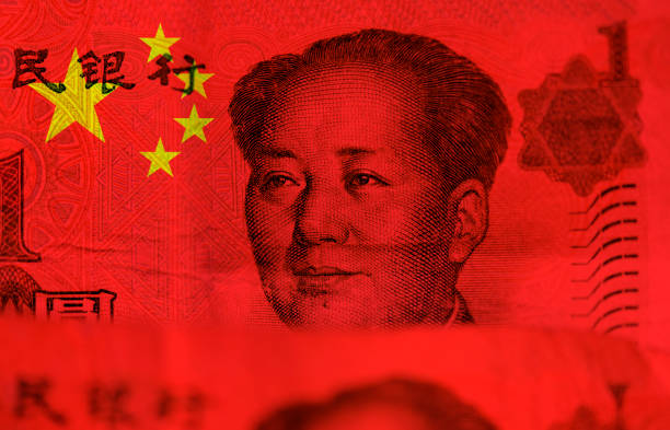 Chinese money, flag of China and face of Mao Zedong Chinese money, flag of China and face of Mao Zedong mao tse tung stock pictures, royalty-free photos & images