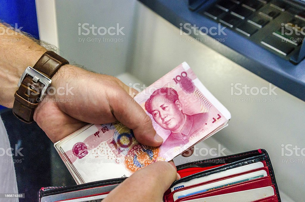 Chinese money from ATM stock photo
