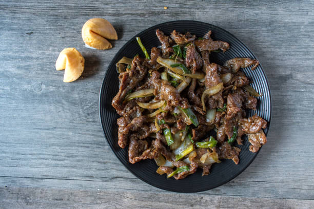 Chinese Mongolian beef Chinese Mongolian beef with fortune cookies top view mongolian culture stock pictures, royalty-free photos & images