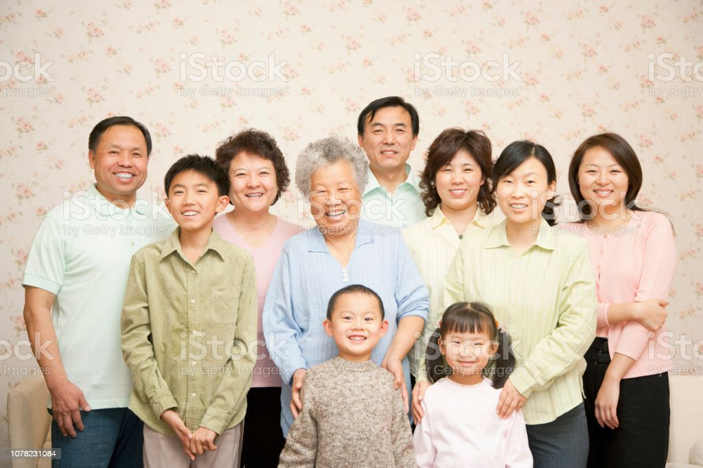 Chinese multigenerational family portrait at home stock photo
