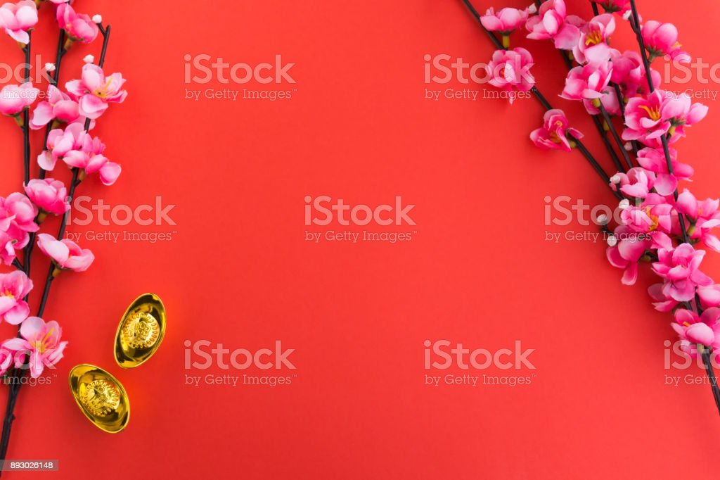 chinese new year background ornaments plum flowers and gold ingots royalty free stock photo