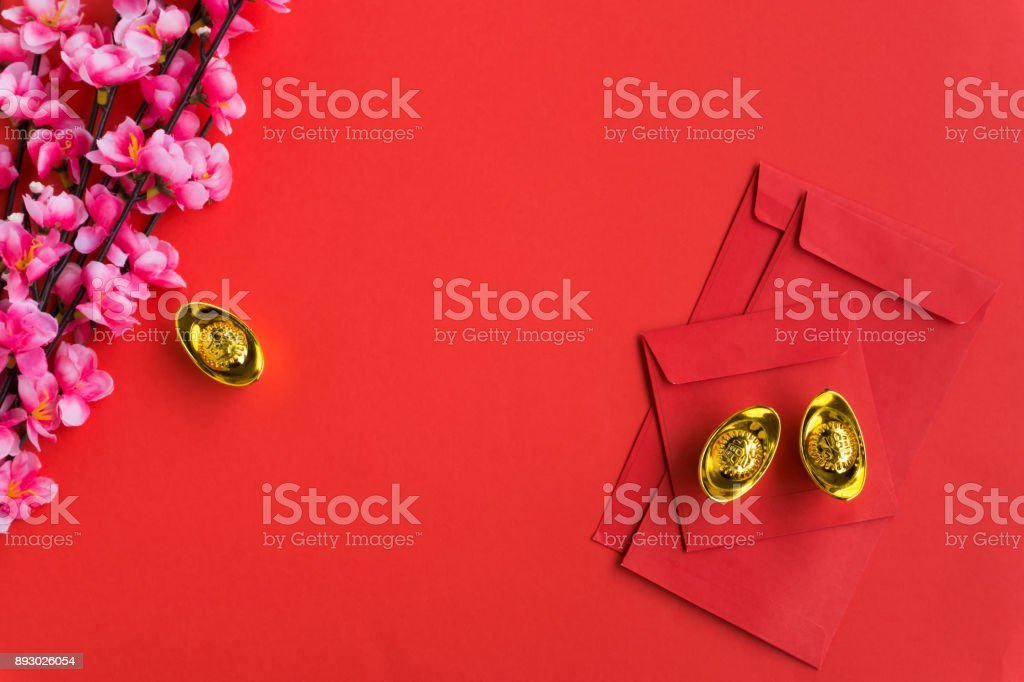 chinese new year background ornaments red envelopes plum flowers and gold ingots royalty