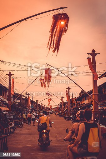 Ko Lanta, Thailand - March 15, 2018: The streets are decorated with colourful lanterns.  It is Chinese New Year and the streets are packed with tourists coming to see the festivities.  The location is Old Town, Ko Lanta, Krabi, Thailand.