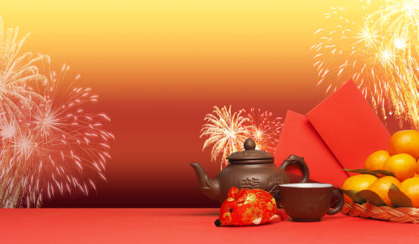 chinese new year. chinese new year festival decorations.the inscription on the teapot is long cha, translation - dragon tea. - chinese new year stock pictures, royalty-free photos & images
