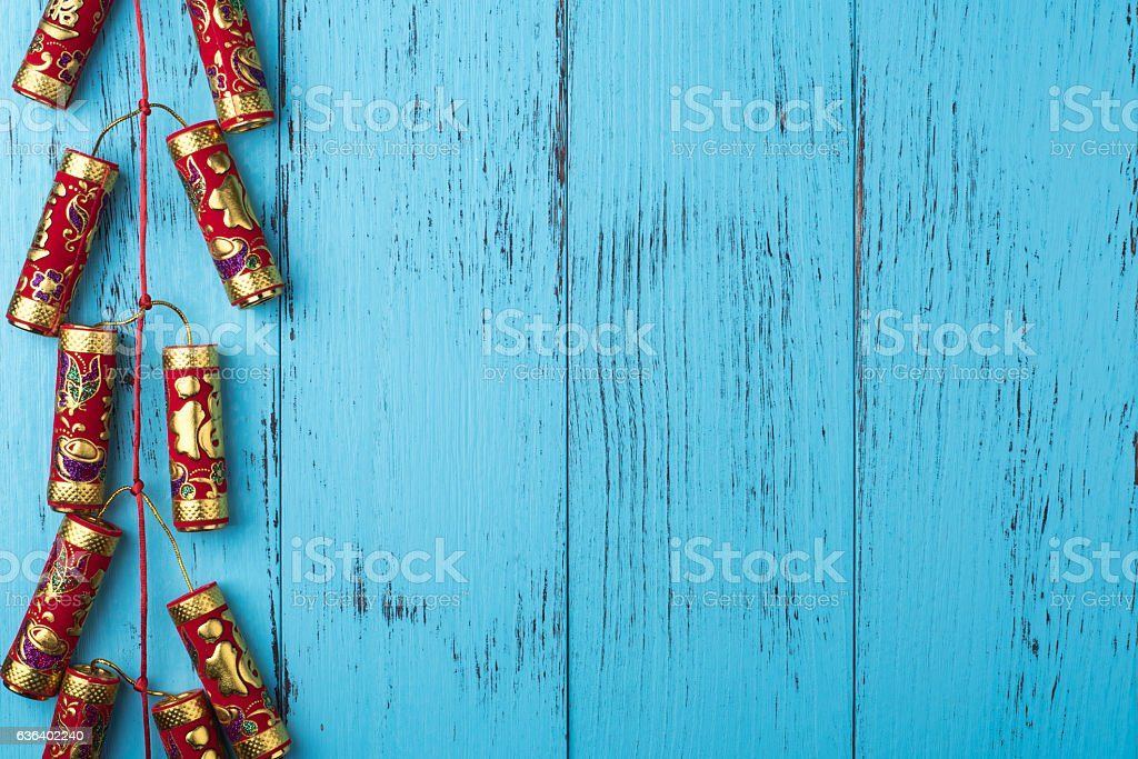 Chinese New Year decoration: firecrackers on weathered blue wood stock photo