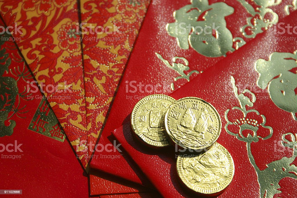 Chinese New Year depicted with coins and cards royalty-free stock photo