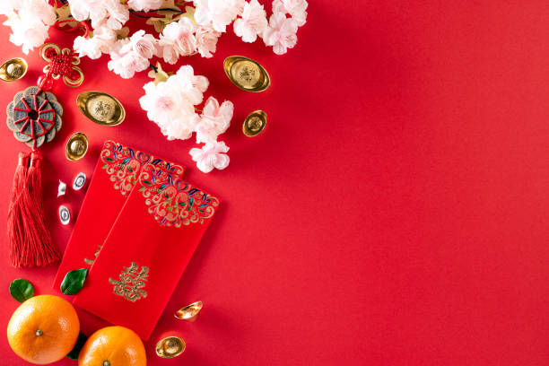 chinese new year festival decorations pow or red packet, orange and gold ingots or golden lump on a red background. chinese characters fu in the article refer to fortune good luck, wealth, money flow. - chinese new year stock pictures, royalty-free photos & images