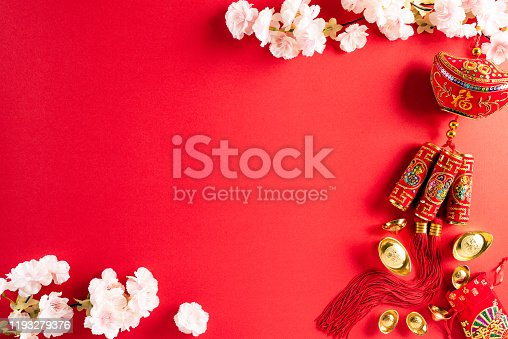 istock Chinese new year festival decorations pow or red packet, orange and gold ingots or golden lump on a red background. Chinese characters FU in the article refer to fortune good luck, wealth, money flow. 1193279376