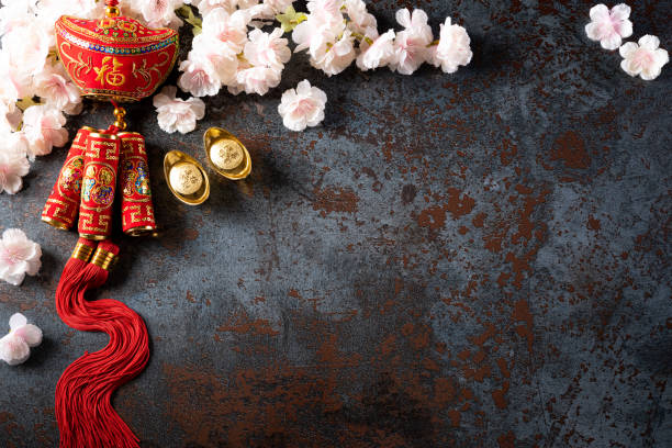 chinese new year festival decorations pow or red packet, orange and gold ingots or golden lump on a black stone texture background. chinese characters fu means fortune good luck, wealth, money flow. - chinese new year stock pictures, royalty-free photos & images