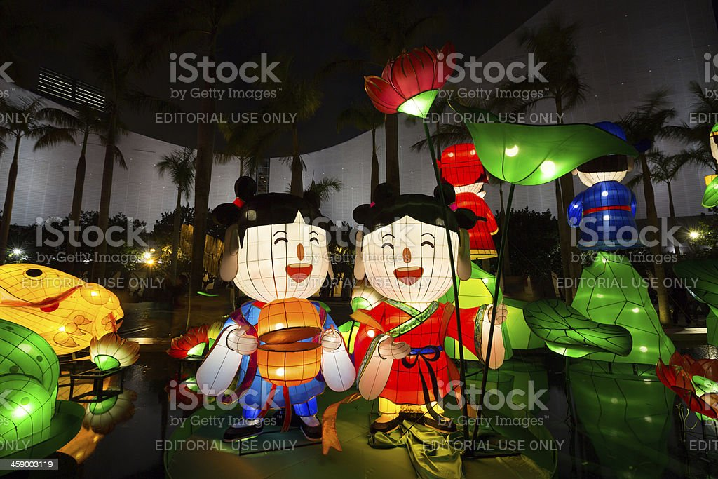 """Chinese New Year Lantern Carnival 2013 """"Hong Kong, China - February 13 , 2013: People at Tsim Sha Tsui District. Chinese New Year lantern decoration in Tsim Sha Tsui, Kowloon, Hong Kong. Decorations are appearing all over the city to celebrate for Chinese New Year and welcomes the year of the Snake."""" 2013 Stock Photo"""