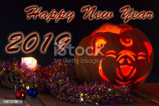 1176499937 istock photo 2019 Chinese New Year of the Pig. Jack's lamp, stylized under the head of a pig 1067979814