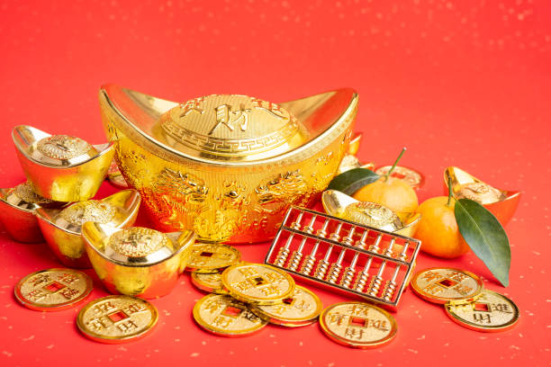 Chinese new year ornament--gold ingot,orange,golden coin and golden abacus stock photo