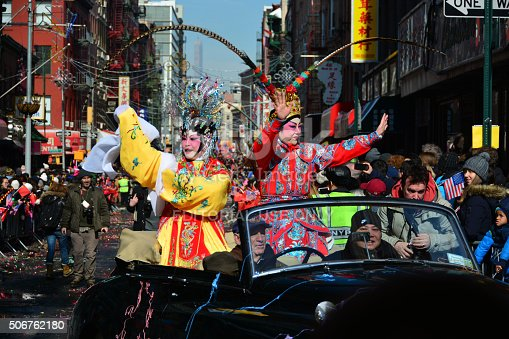 New York, USA - February 22, 2015: People parading in cars at Chinese New Year parade in the streets of New York Chinatown.
