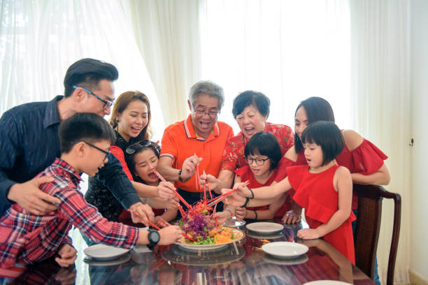 chinese new year reunion dinner with yeesung - chinese new year stock pictures, royalty-free photos & images