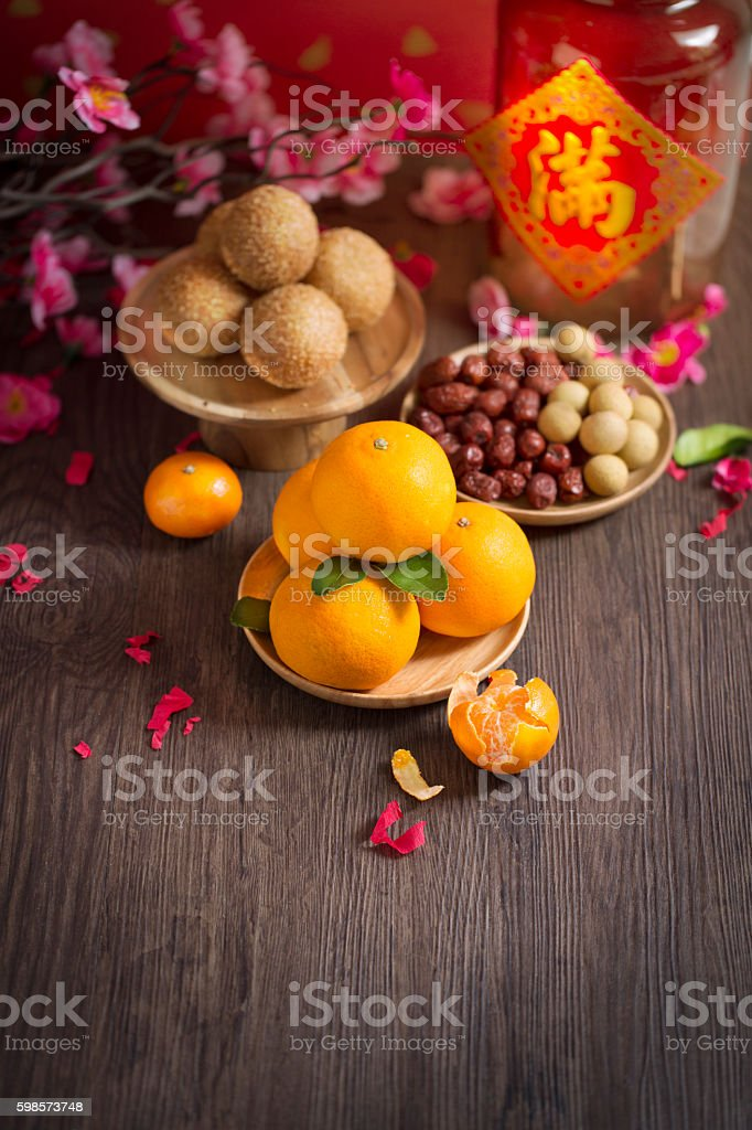 Chinese new year tangerine oranges on wooden table top shot. stock photo