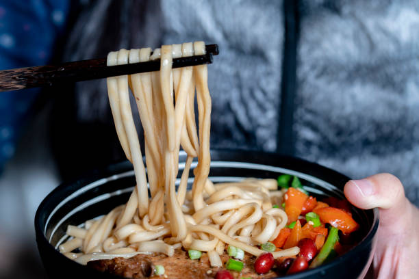 Chinese noodles with braised pork chop stock photo