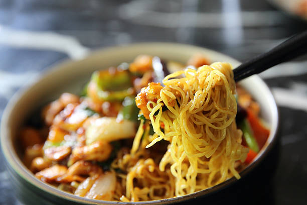 Chinese noodles with chicken and peanuts - Chinese cuisine food stock photo