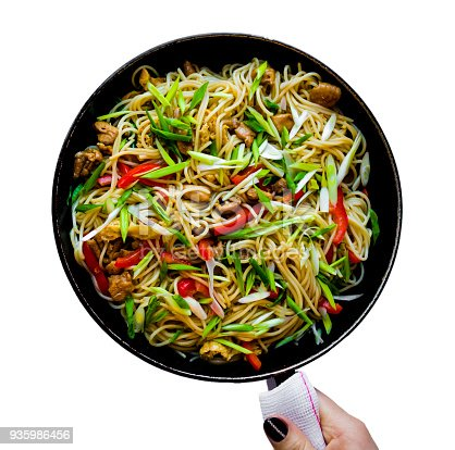 istock Chinese noodles wok isolated in white background 935986456