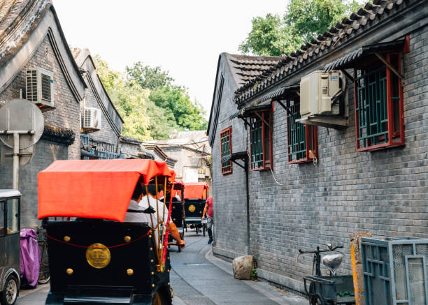 Chinese old street Hutong and traditional rickshaw at Shichahai in Beijing, China stock photo