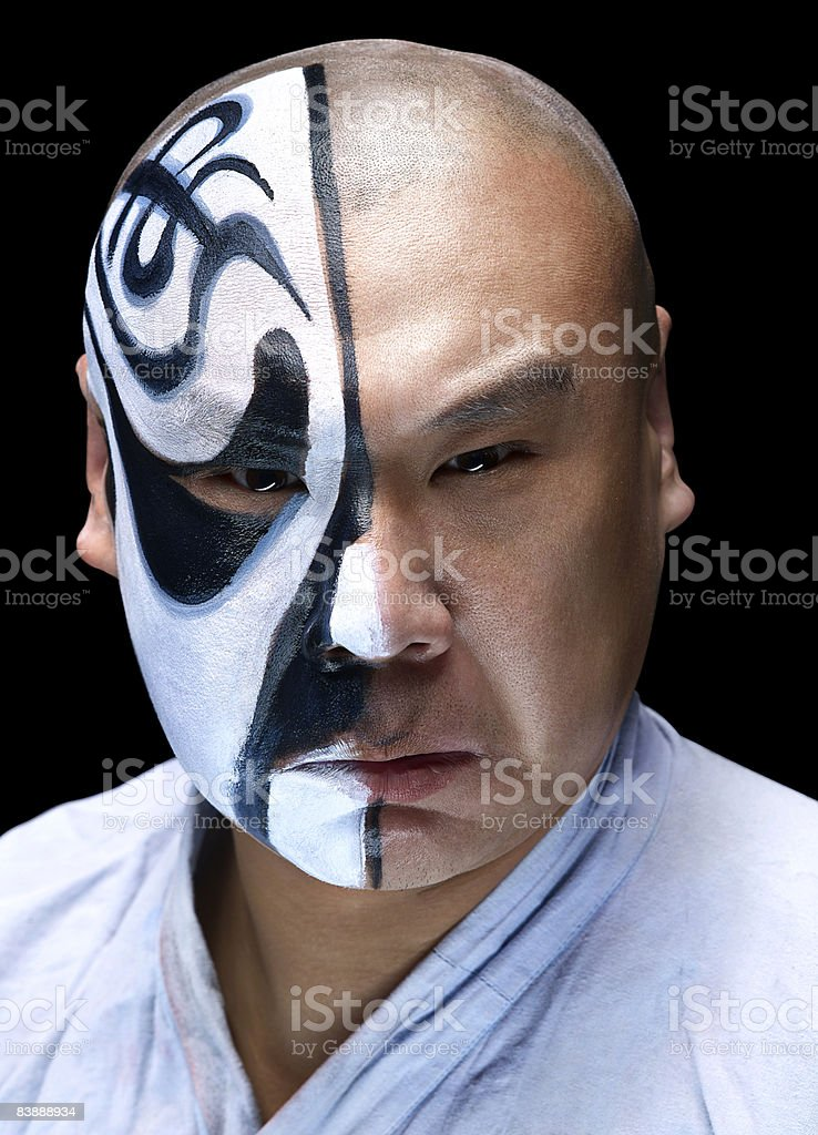 Chinese opera actor with makeup on half of face royalty free stockfoto