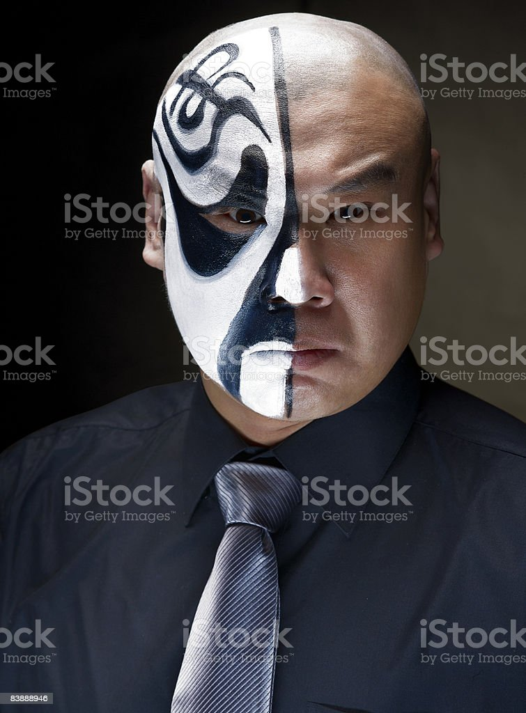 Chinese opera actor with makeup on half of face royalty-free stock photo