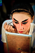 BANGKOK ,THAILAND - October ,01 ,2011:Chinese opera actress painting face for show stage Drama in China Town ,Bangkok ,Thailand.