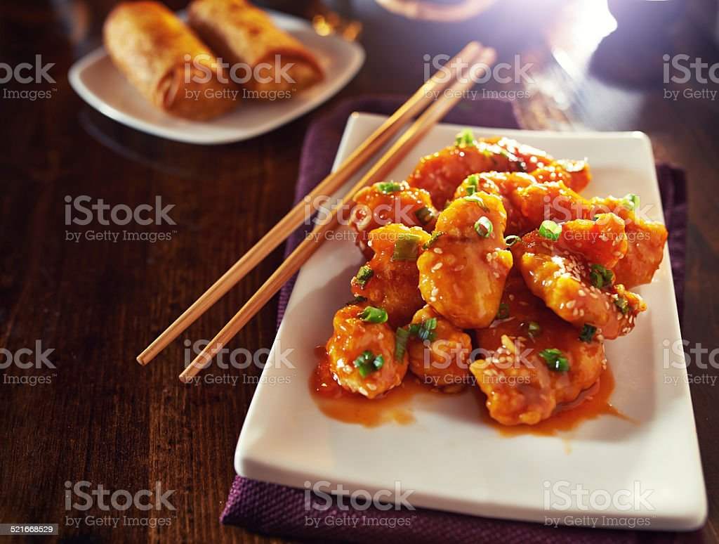chinese orange chicken with chopped green onion stock photo