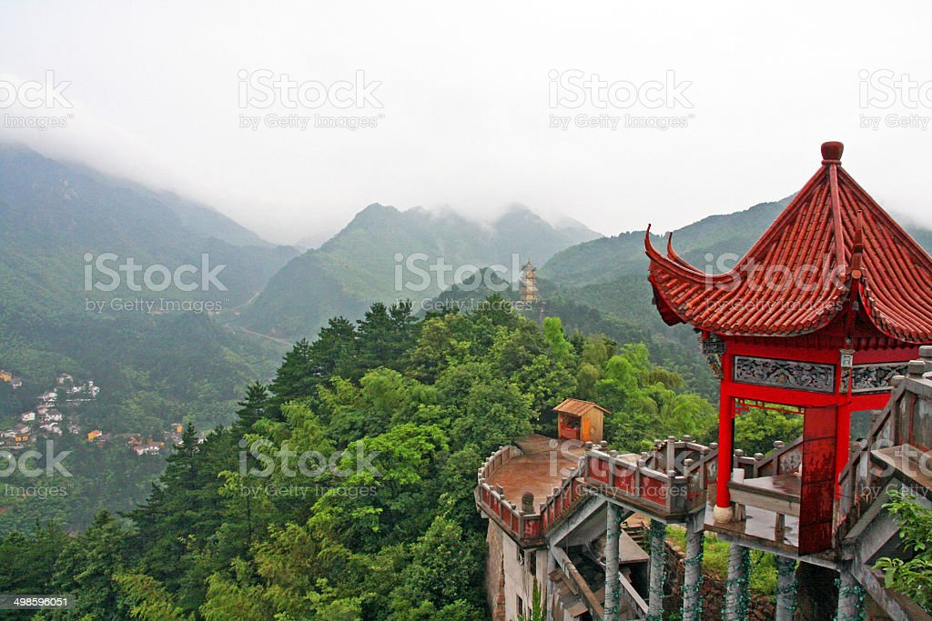 chinese pagoda and misty mountains stock photo