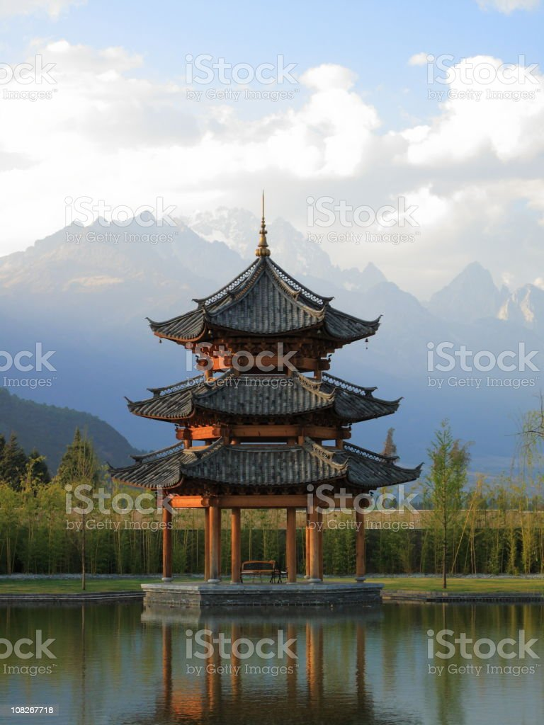 Chinese Pagoda Pavilion with Mountains in Background stock photo